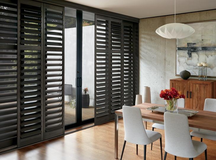 dining room dark interior shutters slidign glass window treatments Maple Grove MN