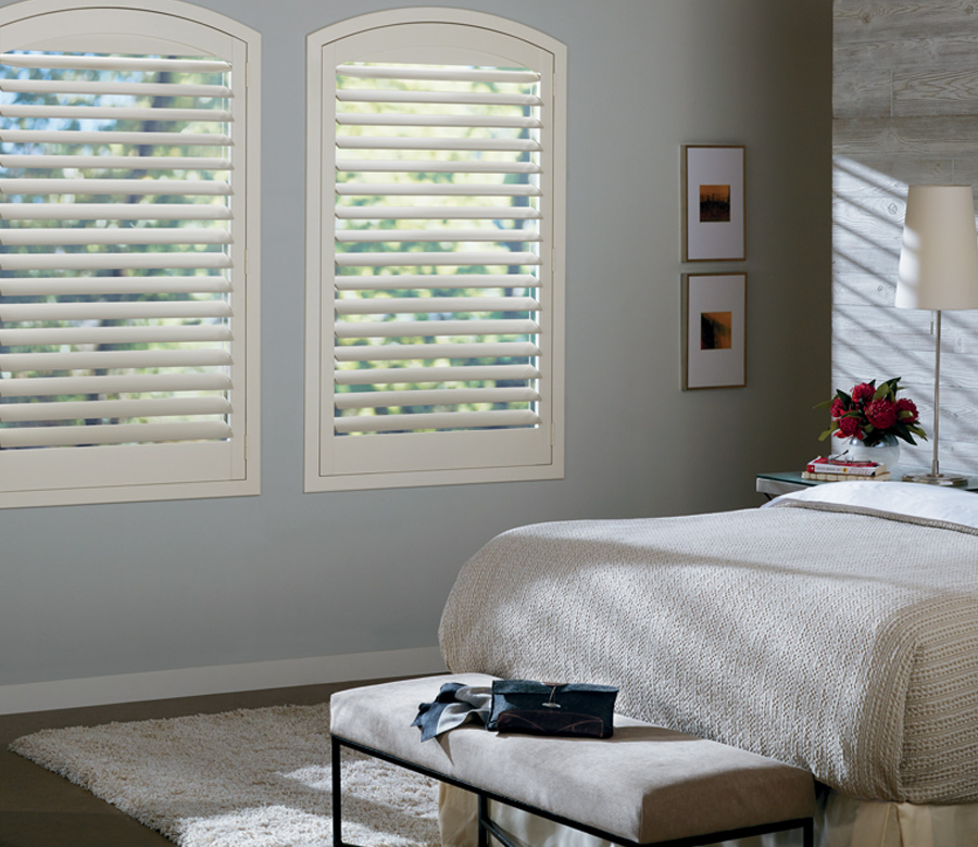 farmhouse inspired bedroom with white plantation shutters Burnsville mn