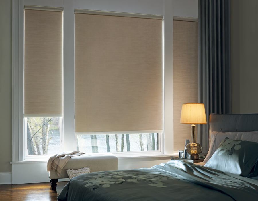 beautifully decorated guest room roller shades Hunter Douglas St Paul 55113