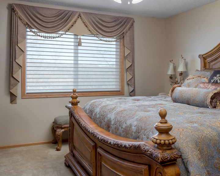 bedroom window with fabric valance top treatments Maple Grove MN