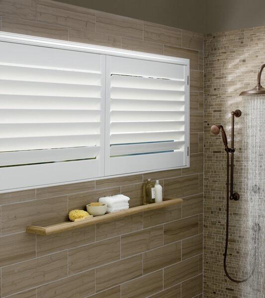 bathroom window treatments Hunter Douglas motorized shutters St Paul MN