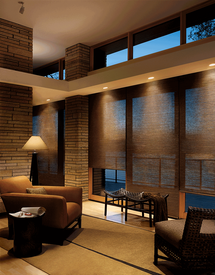 family room automated designer roller screen shades covering floor to ceiling windows Hunter Douglas St Paul 55113