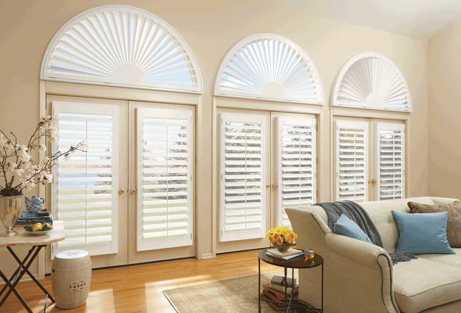 living room arched window treatments plantation shutters Hunter Douglas Maple Grove 55369