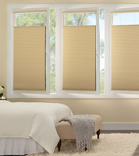 bedroom with European turn tilt windows gold duette honeycomb shades Minneapolis MN