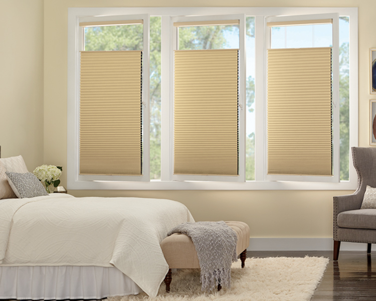 bedroom with European turn tilt windows gold duette honeycomb shades Minneapolis MN