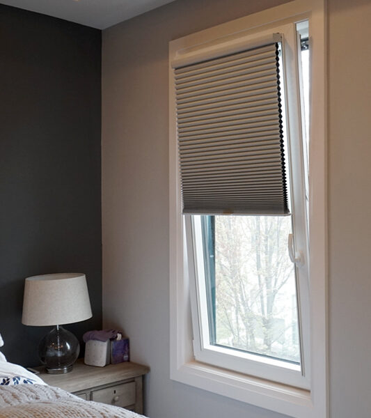 bedroom gray walls open turn tilt window with duette honeycomb shade track glide system St Paul