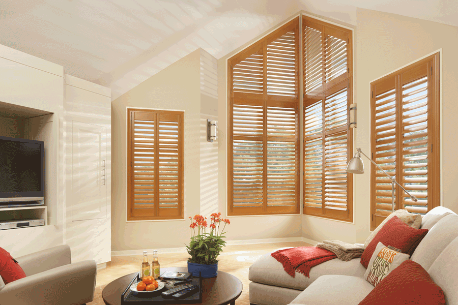 Custom plantation shutters on corner and angled window in Minneapolis home.