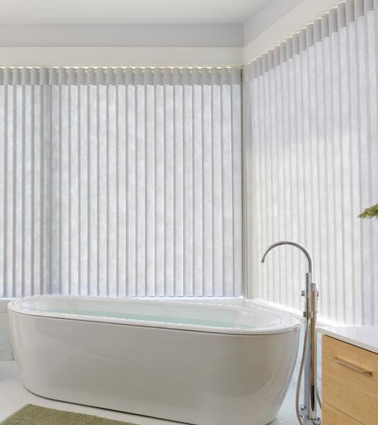 bathroom corner window with luminette vertical shades in Maple Grove 55369
