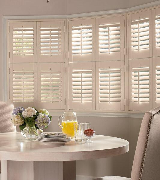 breakfast nook with plantation shutters on bay windows St Paul 55113