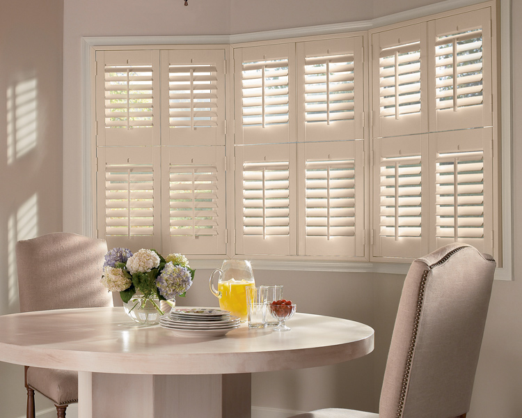 breakfast nook with plantation shutters on bay windows St Paul 55113