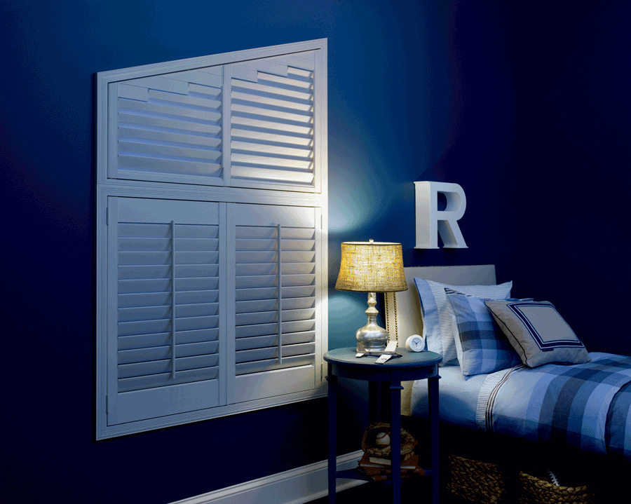 Child's bedroom at night with white plantation shutters on the window in Minneapolis.
