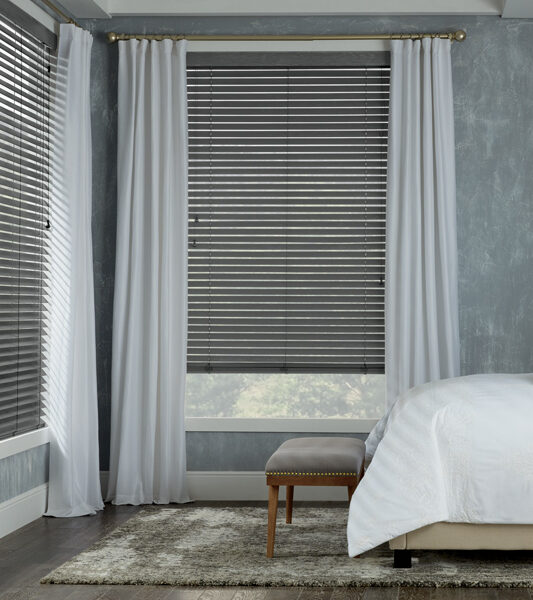 corner windows covered with blinds and drapery panels Maple Grove MN