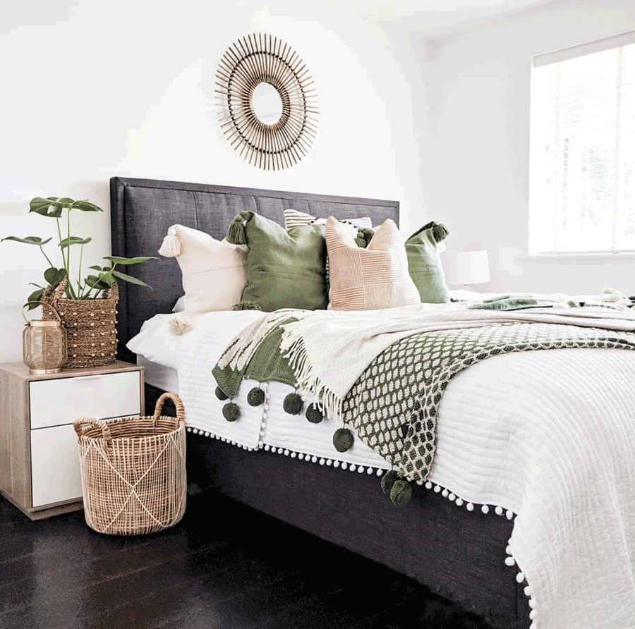 Cozy chic bedroom in Minneapolis, MN with pops of green and a style statement color pallet.