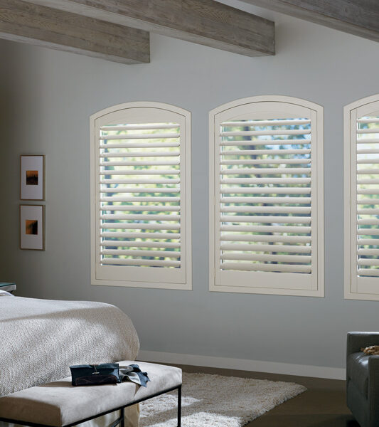 master bedroom with plantation shutters for arched window treatments Maple Grove 55369