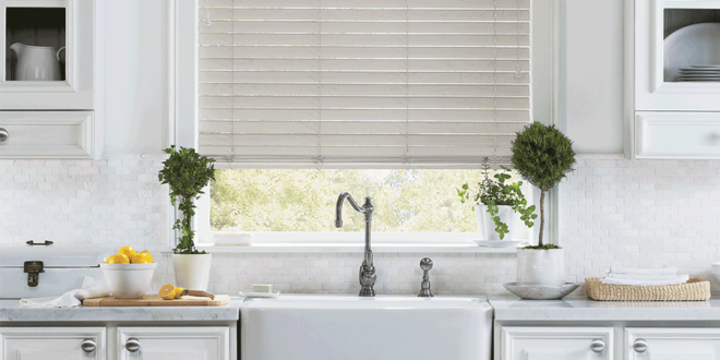 Farmhouse window treatments above kitchen sink in Minneapolis home.