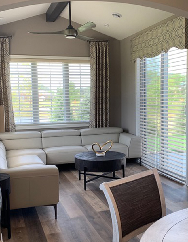 living room with hunter douglas silhouette shades on sliding glass doors Burnsville 55337