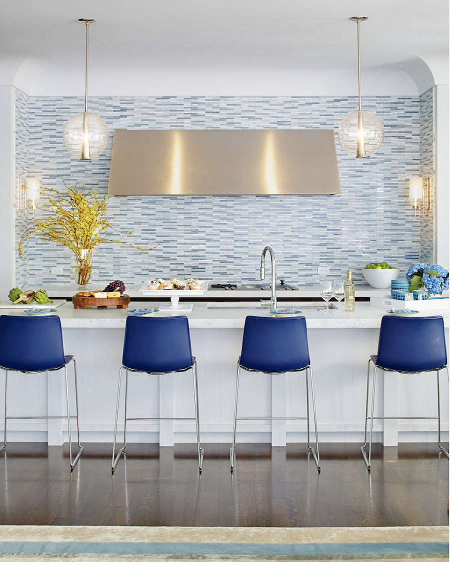 blue chairs in a modern kitchen with blue tile backsplash