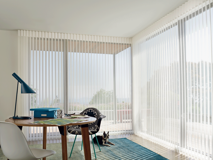 Sheer window treatments allow the natural light to flood into your home office.
