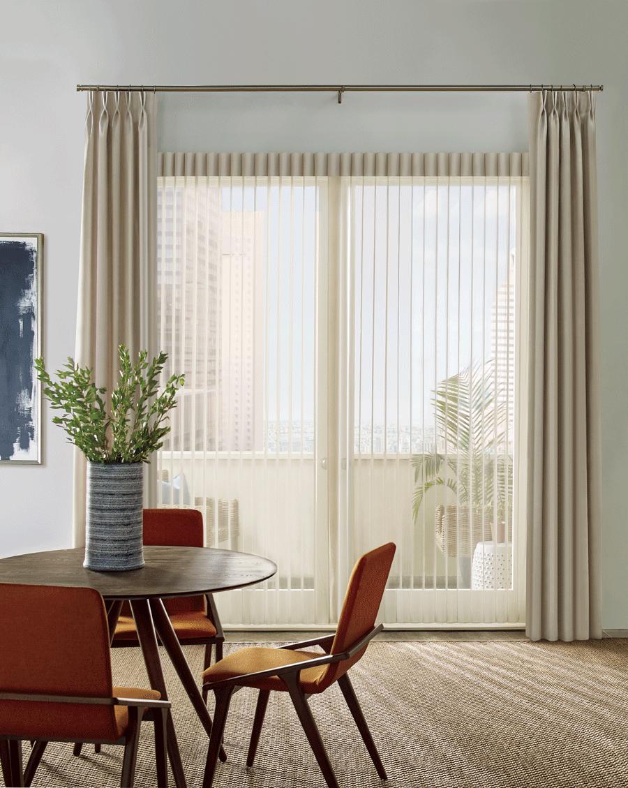 Privacy sheers paired with side drapery panels in dining room.