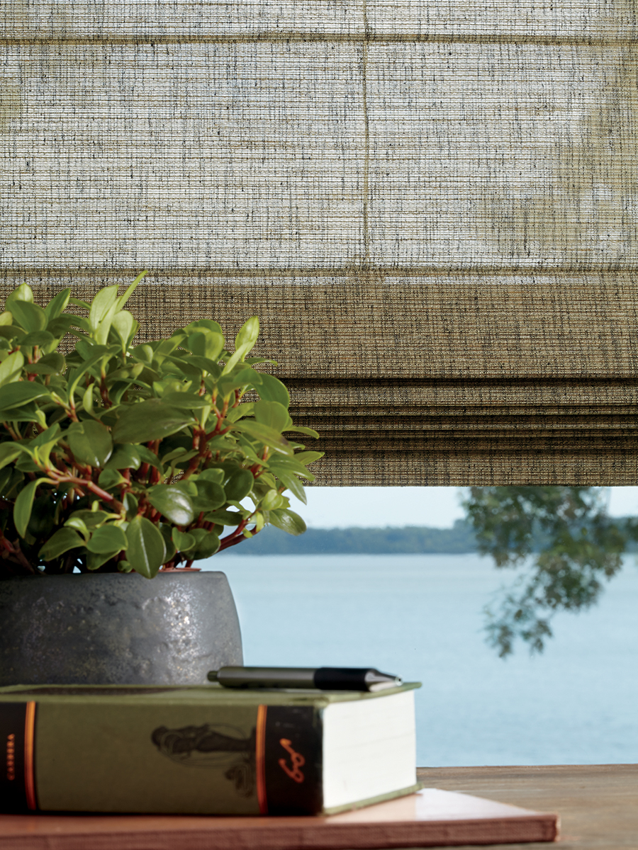 Nature inspired woven textured roman shades.