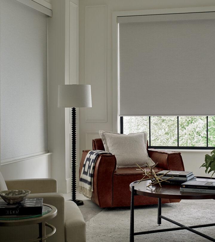 beige corner nook with brown accent chair next to window