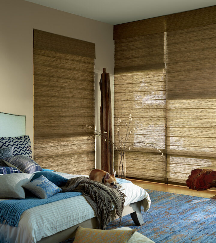 bedroom with tall windows covered with dual roman shades in Burnsville MN
