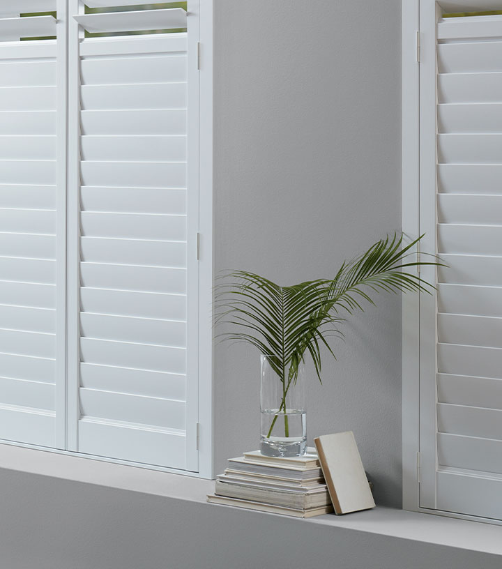white plantation shutters for energy efficiency in St Paul MN