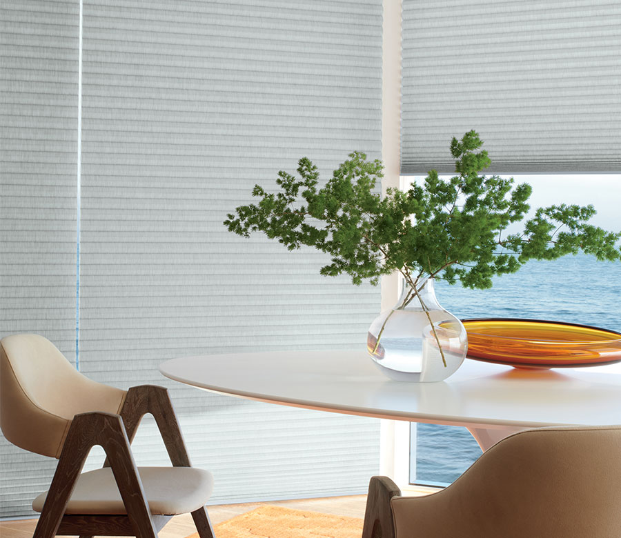 gray duette honeycomb shades in dining area in Little Canada MN