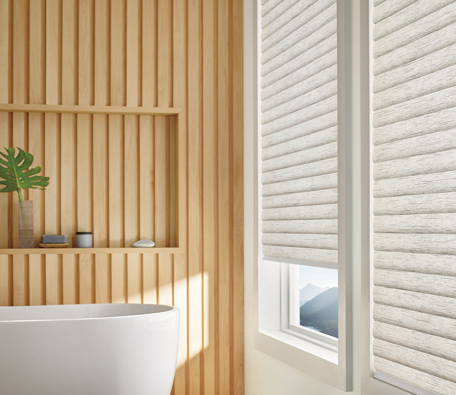 bathroom wall of windows covered with cellular roller shades in Minneapolis MN