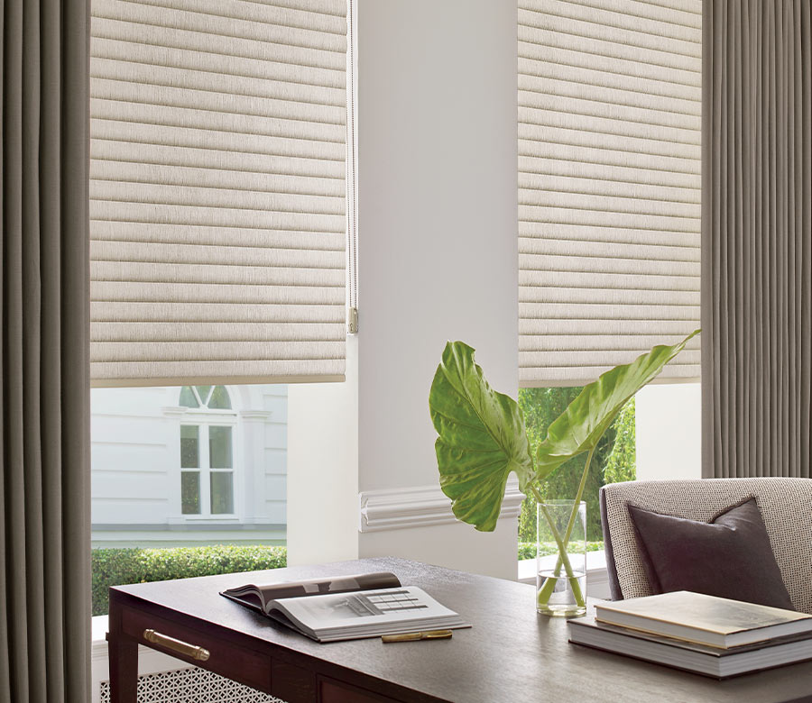 home office in St Paul MN with beige roller shades and side draperies