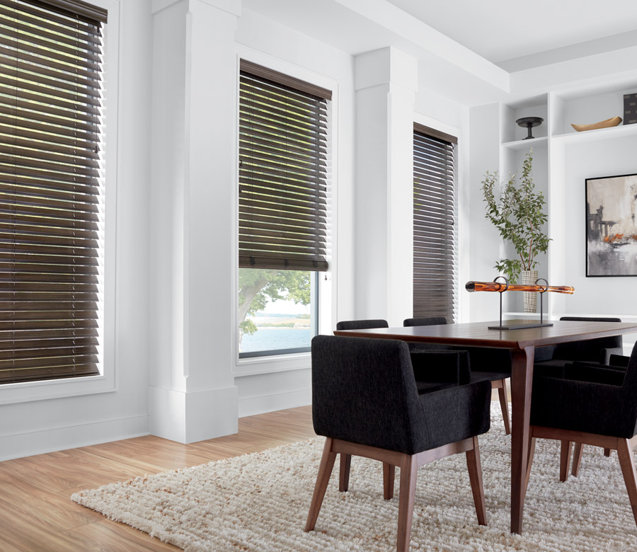 dining room with dark faux wood blinds in Maple Grove MN