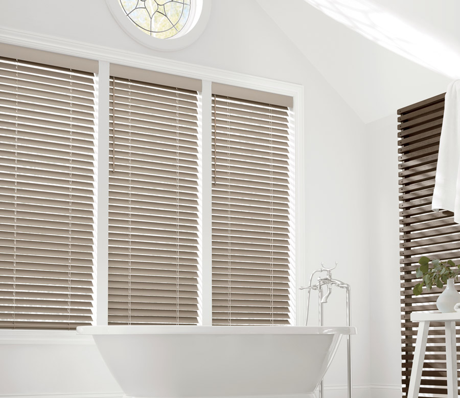 contemporary bathroom with faux wood blinds as bathroom window coverings in St Paul MN