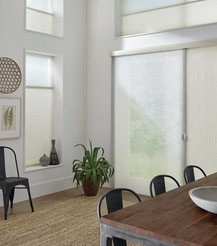 dining room with honeycomb shades for sliding glass doors in Burnsville MN
