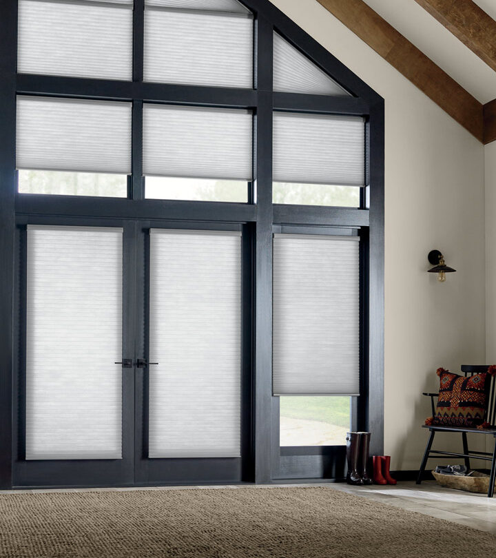 entryway windows and door cover glass doors with motorized cellular shades in Minneapolis home