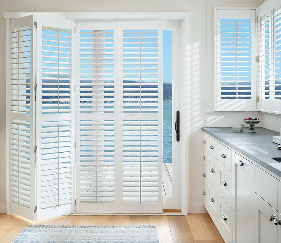 Lake view of slider fitted with palm beach shutters in Minneapolis MN home