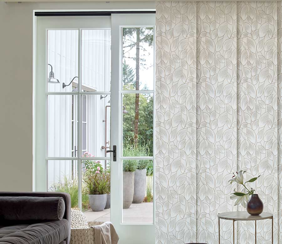 gray patterned panel track blinds covering doors in Maple Grove MN home