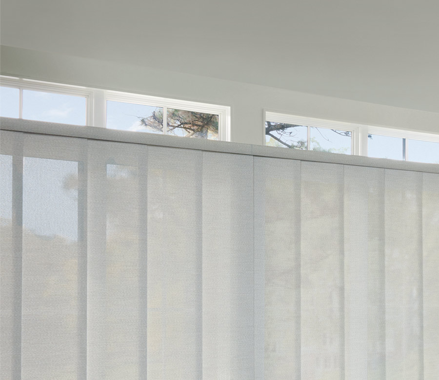 white panel track blinds on large wide windows in Burnsville MN home