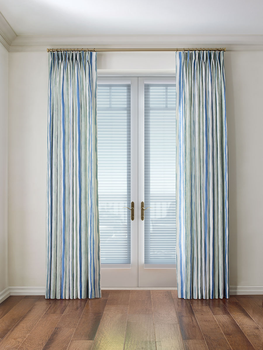 draperies over french doors with honeycomb shades in Maple Grove MN