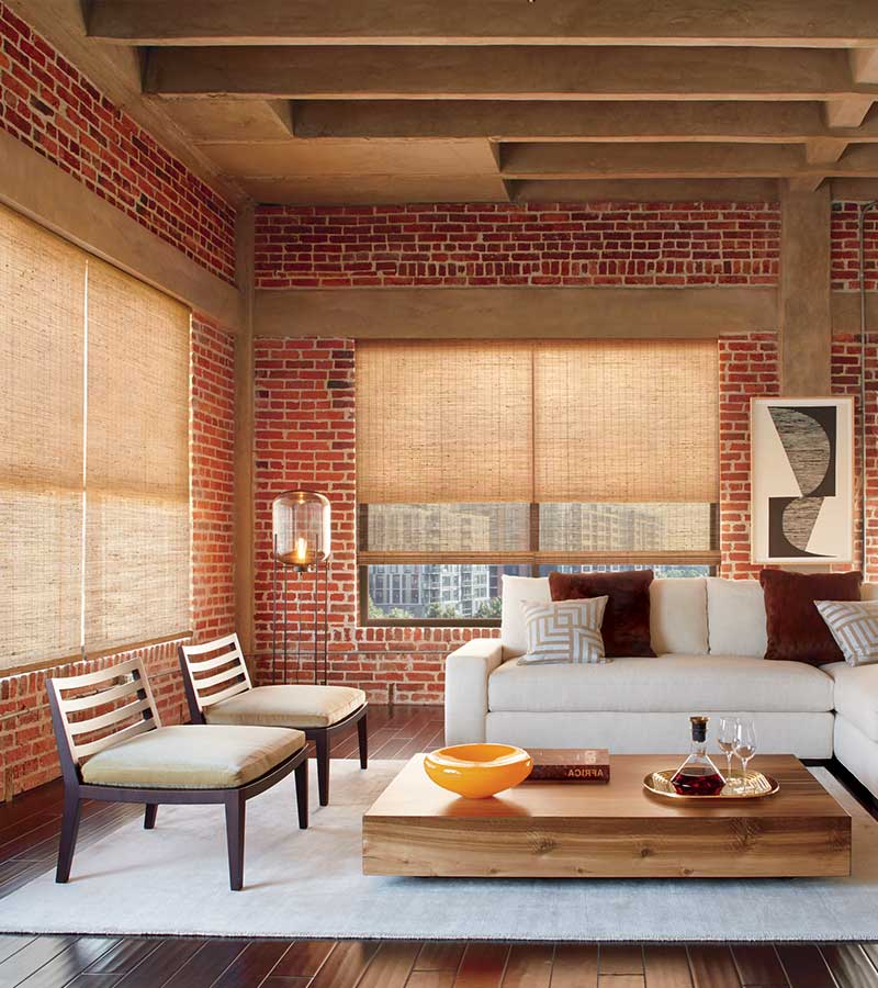 exposed brick loft with woven wooden window shades in Minneapolis MN
